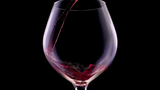 slow motion red wine pouring - bicchiere da vino video stock e b–roll