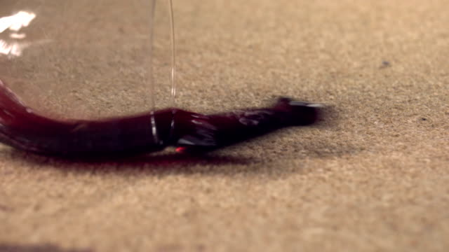 slow motion red wine spilling on carpet - stained stock videos & royalty-free footage