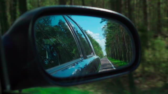 Slow motion: Road on a side mirror