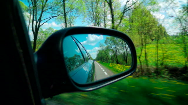 slow motion: road on a side mirror - side view stock videos & royalty-free footage