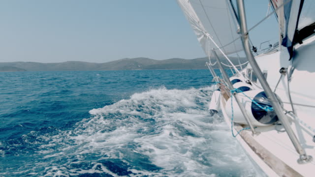 ms slow motion sailboat heeling along sunny blue ocean,croatia - mast sailing stock videos & royalty-free footage