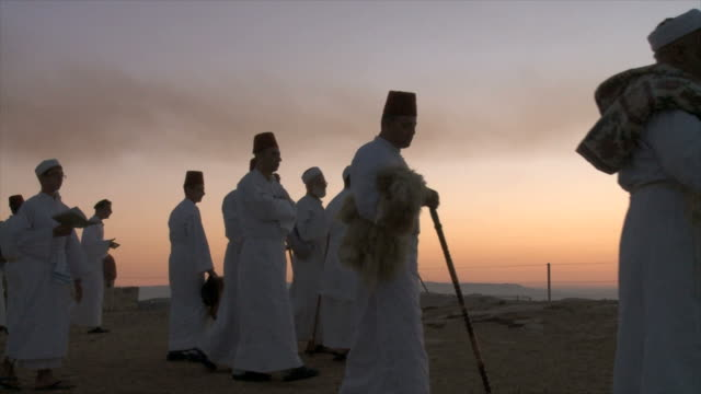 slow motion, samaritan pilgrims congregate before sunrise at mount gerizim near west bank city of nablus,samaria - religious celebration stock videos & royalty-free footage