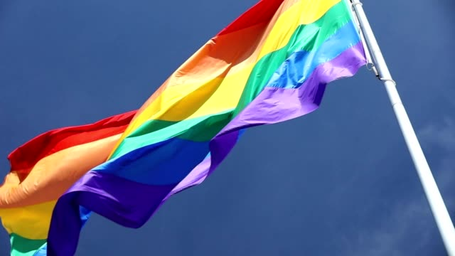 slow motion san francisco rainbow flag flying - rainbow flag stock videos & royalty-free footage
