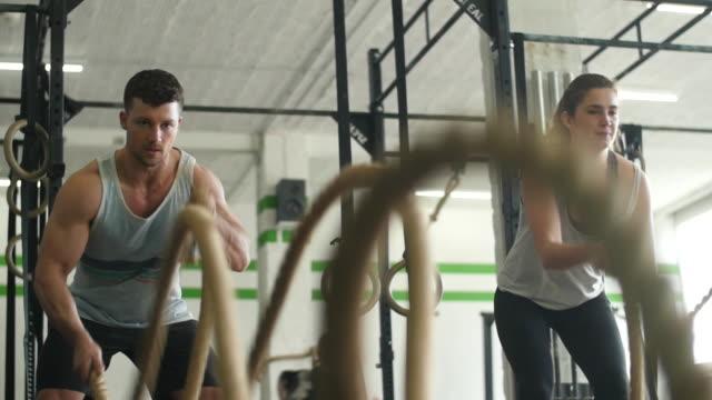 Slow motion scene of gym battle rope exercises