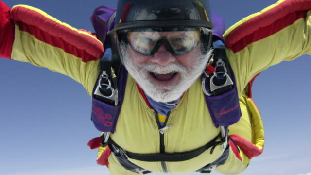 slow motion - senior skydiver exhilarated in free fall - free falling stock videos & royalty-free footage