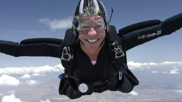 slow motion - senior skydiver exhilarated in free fall - skydiving stock videos & royalty-free footage