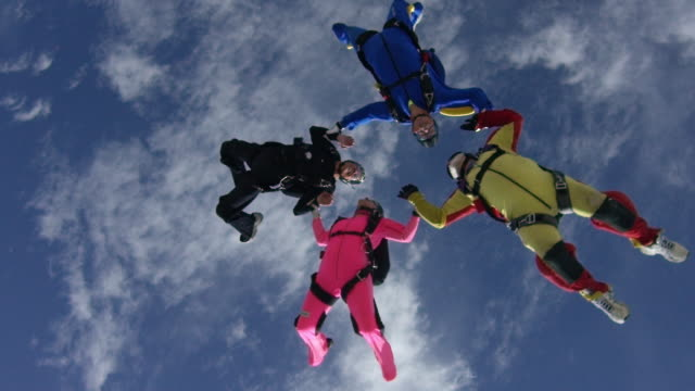 slow motion - senior skydiver in formation - free falling stock videos & royalty-free footage