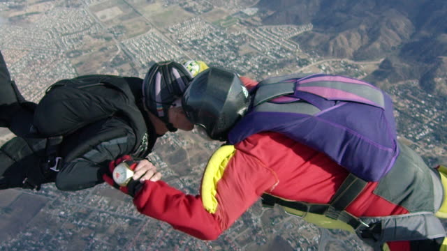 Slow Motion - Senior Skydivers Kiss In Free Fall