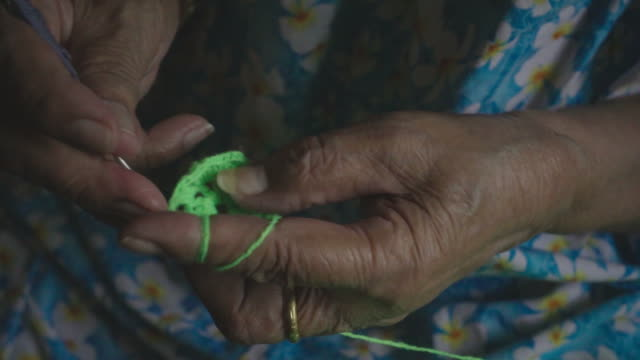 slow motion : senior woman knitting