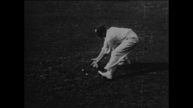 slow motion sequence featuring surrey and england cricketer jack hobbs as he demonstrates his fielding and throwing techniques at the kennington oval... - squadra di cricket video stock e b–roll