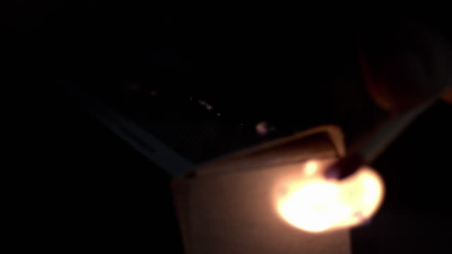 stockvideo's en b-roll-footage met slow motion sequence of a match being struck. - lucifer