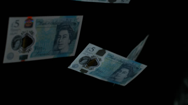 slow motion sequence showing five pound notes falling to the floor - super slow motion stock videos & royalty-free footage