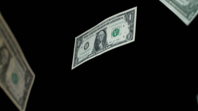 vídeos de stock e filmes b-roll de slow motion sequence showing one dollar bills falling to the floor. - nota de dólar dos estados unidos