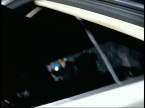slow motion SHAKY low angle close up rottweiler barking in front seat of police car at night