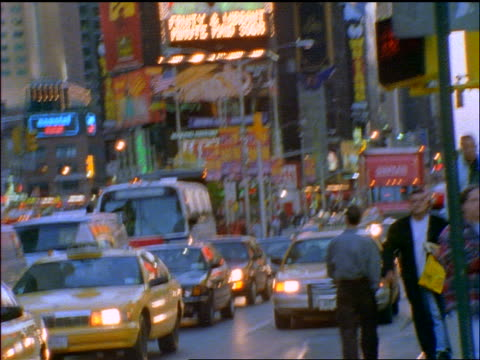 slow motion shaky tilt down traffic in times square at dusk / new york city - 1998 stock videos & royalty-free footage