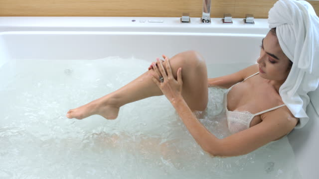 4k slow motion she was going to take a shower in the bathtub. - vortex stock videos & royalty-free footage