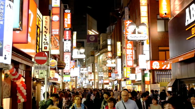 hd slow motion: shibuya shopping street in tokyo - tokyo japan stock videos and b-roll footage