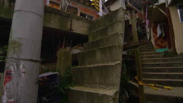 vídeos de stock, filmes e b-roll de slow motion shot inside favela neighborhood in rio de janeiro, brazil - fotografia de alta velocidade
