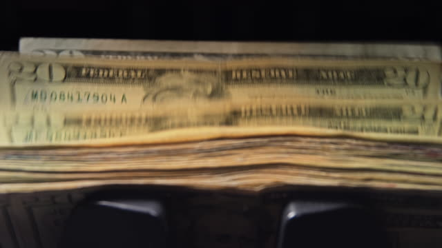 slow motion shot of $20 bills in money counting machine - twenty us dollar note stock videos & royalty-free footage