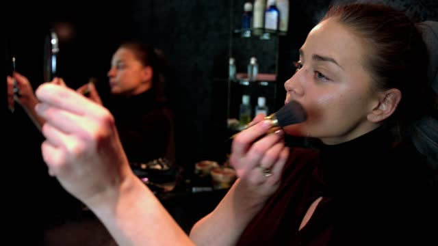 slow motion shot of a beautiful woman doing her make up applying blusher - blusher stock videos & royalty-free footage