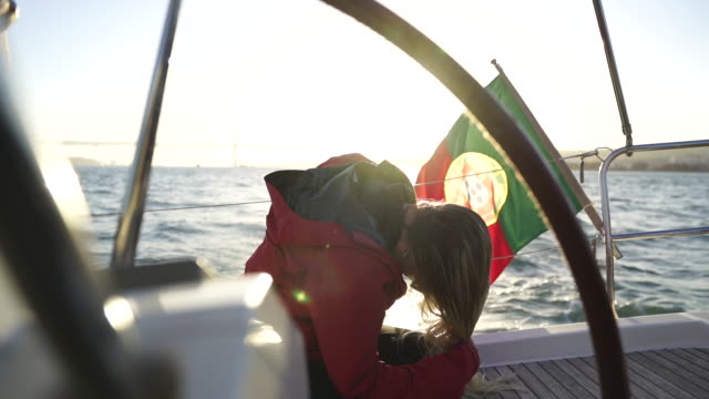 stockvideo's en b-roll-footage met slow motion shot of a blond woman whipping her hair on a boat - portugese cultuur