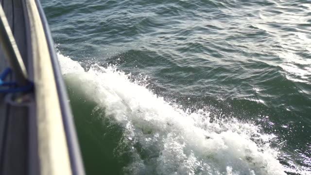 slow motion shot of a boats wake - nautical vessel video stock e b–roll