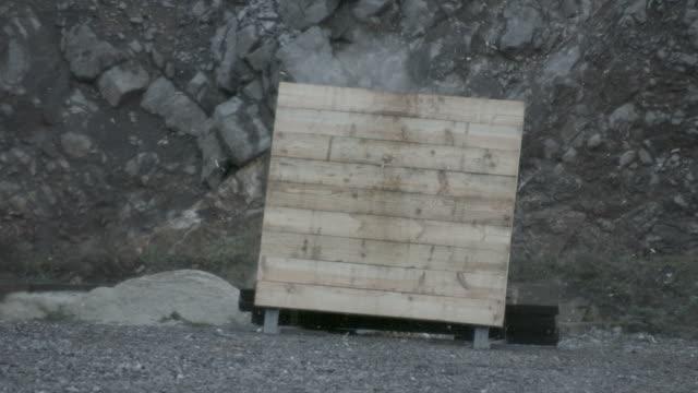 slow motion shot of a cannon ball smashing through a wooden target. - militärmål bildbanksvideor och videomaterial från bakom kulisserna