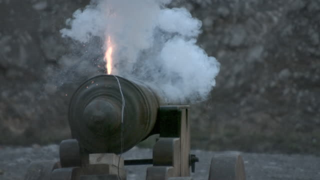 slow motion shot of a cannon firing a cannon ball. - cannon stock videos & royalty-free footage