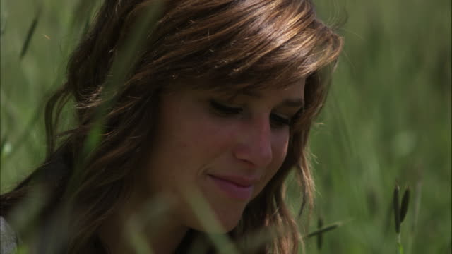 stockvideo's en b-roll-footage met slow motion shot of a face of a pleasant woman. - orem utah