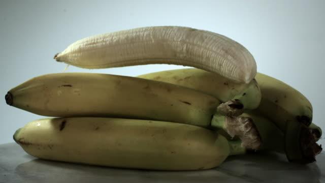 slow motion shot of a falling banana. - slip banana stock videos & royalty-free footage