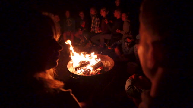 slow motion shot of a group of young teens around a bonfire at night - 20 29 years stock videos & royalty-free footage