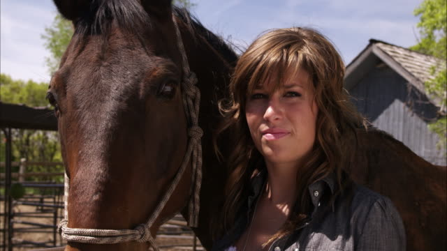vidéos et rushes de slow motion shot of a woman with her horse. - animaux au travail