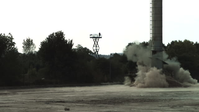slow motion shot of an industrial chimney being demolished. - chimney stock videos & royalty-free footage