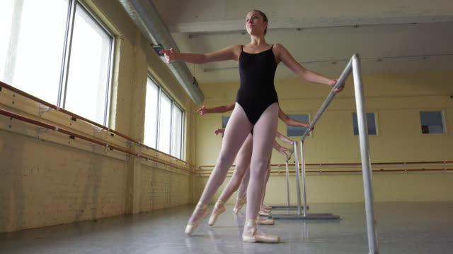 slow motion shot of ballerinas practicing at the barre - leotard stock videos and b-roll footage