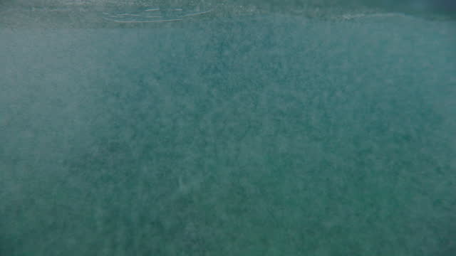 slow motion shot of bubbles under turquoise ocean - oahu, hawaii - oahu stock videos & royalty-free footage