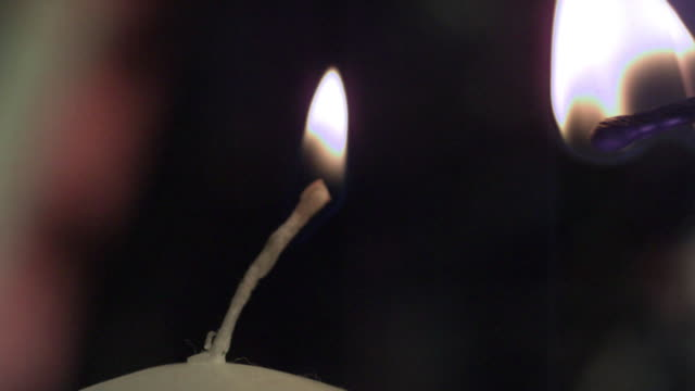 slow motion shot of candle being lit by a match. - candle stock videos & royalty-free footage