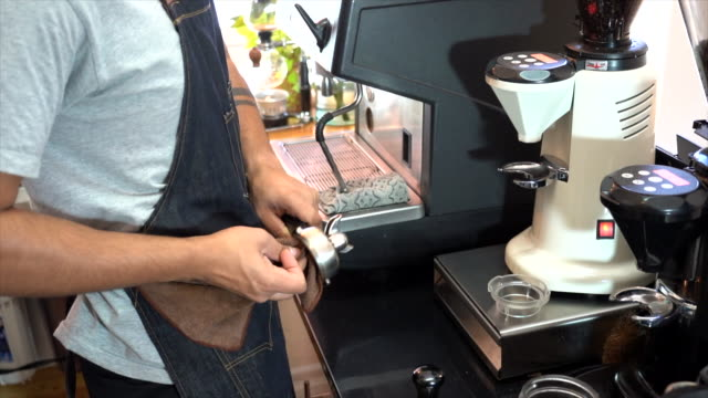 slow motion shot of close up of barista making  a cups of coffee drink - coffee drink stock videos & royalty-free footage