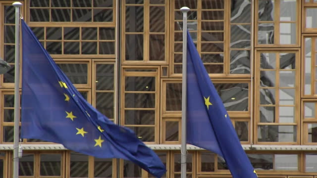 slow motion shot of eu flags waving in brussels - eu flag stock videos & royalty-free footage