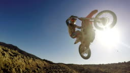 Slow Motion shot of Extreme Motocross Rider On Dirt Track