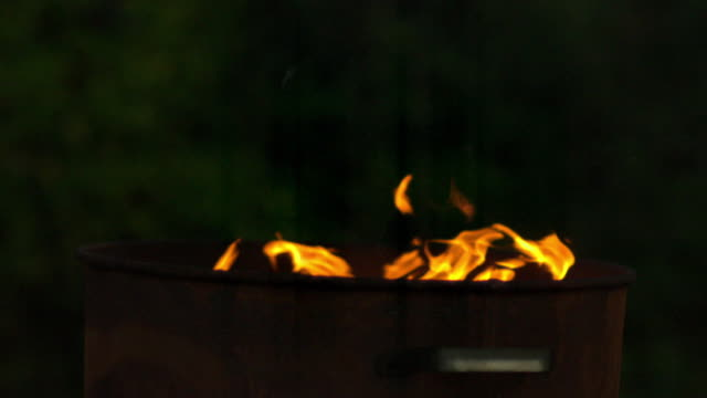 slow motion shot of flames pouring out of a metal bin. - bin stock videos & royalty-free footage