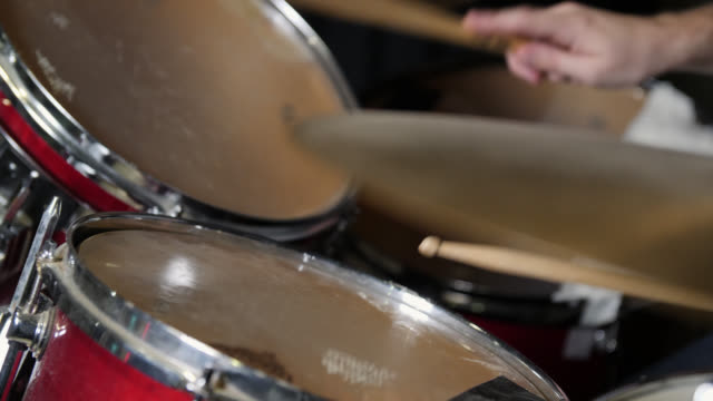 slow motion shot of high and mid toms being hit on a drum kit - drummer stock videos & royalty-free footage