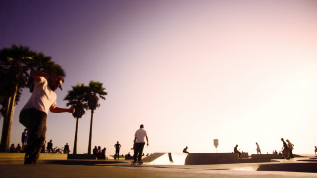 slow motion shot of jumping rollerblader at ocean front walk near venice beach, california - venice beach stock videos and b-roll footage