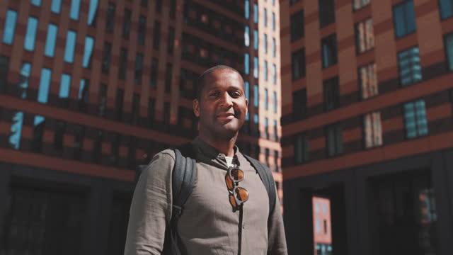 slow motion shot of man looking at camera in city - amsterdam bildbanksvideor och videomaterial från bakom kulisserna