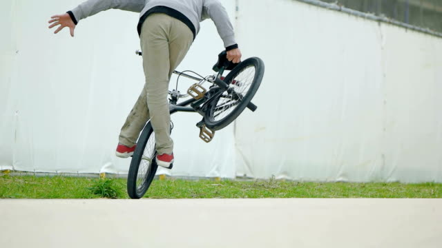 slow motion shot of man with bmx. - freestyle bmx stock videos and b-roll footage