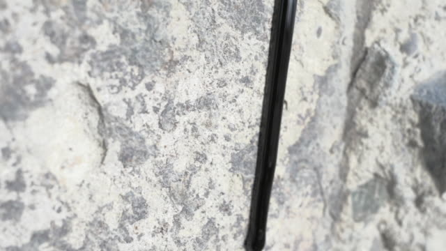 slow motion shot of oil sliding down a stone wall. - baku video stock e b–roll
