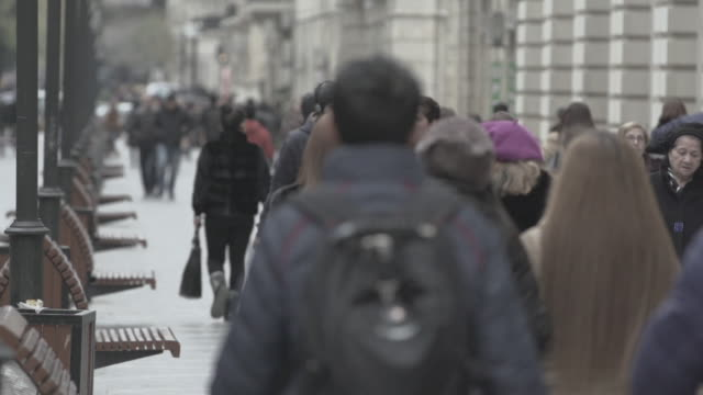 slow motion shot of pedestrians walking down a street in baku. - baku video stock e b–roll