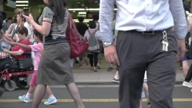 slow motion shot of pedestrians walking.tokyo.japan - randoseru stock videos & royalty-free footage