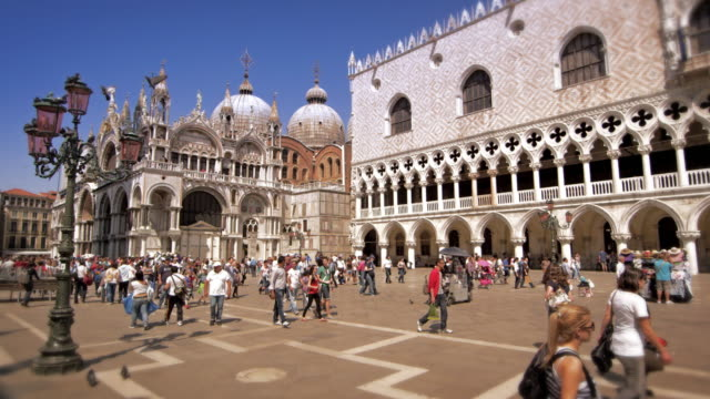 slow motion shot of people walking through piazza san marco - palace stock-videos und b-roll-filmmaterial