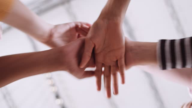 slow motion shot of people's hands cheering, low angle view - five people stock videos & royalty-free footage