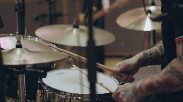 slow motion shot of rock band recording in studio. - skill stock videos & royalty-free footage